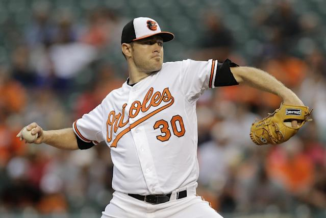 Baltimore Orioles starting pitcher Chris Tillman throws to the Boston Red Sox in the first inning of a baseball game, Tuesday, June 10, 2014, in Baltimore. (AP Photo/Patrick Semansky)