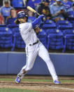 Toronto Blue Jays' Bo Bichette follows through on a two-run double off Los Angeles Angels reliever Jaime Barria during the fourth inning of a baseball game Saturday, April 10, 2021, in Dunedin, Fla. (AP Photo/Steve Nesius)