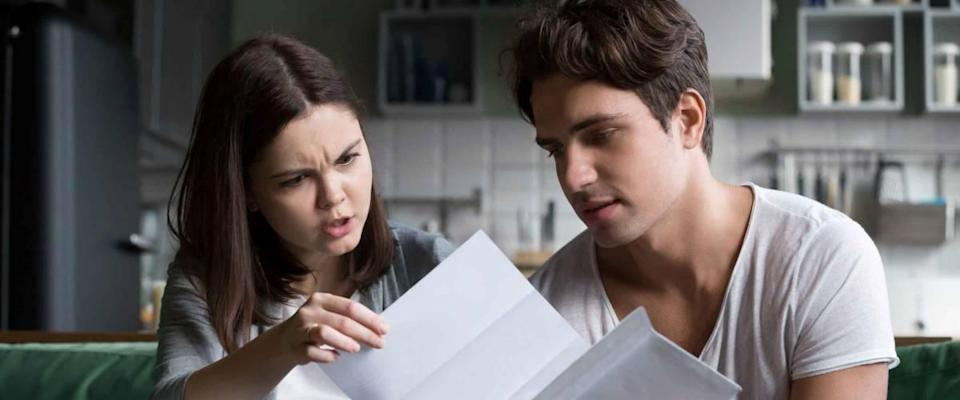 Couple looking at bills worried