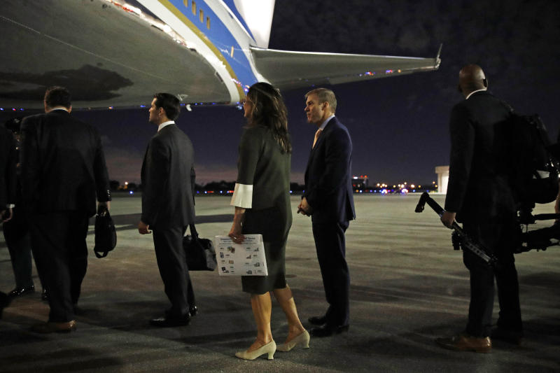 Rep. Jim Jordan, R-Ohio, center, boards Air Force One en route to Andrews Air Force Base, Md., after attending President Donald Trump's speech at the Israeli American Council National Summit in Hollywood, Fla., Saturday, Dec. 7, 2019. (AP Photo/Patrick Semansky)