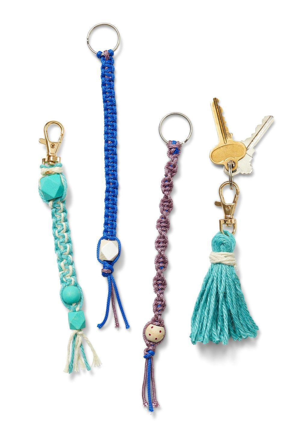 """<p>Channel your summer camp craft skills, and make a <a href=""""http://blog.darice.com/kids-crafts/how-to-make-boondoggle-keychains/"""" rel=""""nofollow noopener"""" target=""""_blank"""" data-ylk=""""slk:cute woven lanyard"""" class=""""link rapid-noclick-resp"""">cute woven lanyard</a> or <a href=""""https://www.kenarry.com/diy-tassel-keychains/"""" rel=""""nofollow noopener"""" target=""""_blank"""" data-ylk=""""slk:tassel keychain"""" class=""""link rapid-noclick-resp"""">tassel keychain</a> — there are tons of great DIY tutorials on YouTube.</p>"""