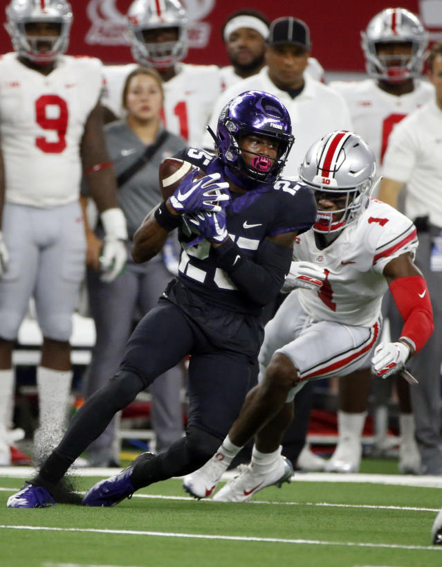 TCU wide receiver KaVontae Turpin (25) catches a pass in front of Ohio State cornerback Jeffrey Okudah (1) during the first half of an NCAA college football game in Arlington, Texas, Saturday, Sept. 15, 2018. (AP Photo/Michael Ainsworth)