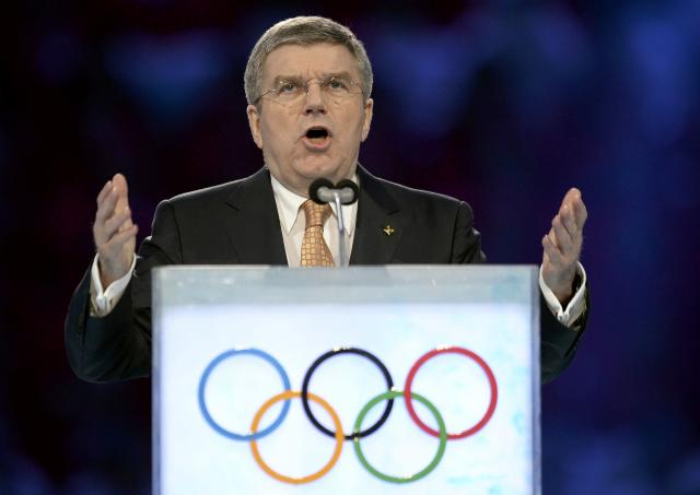 International Olympic Committee President Thomas Bach speaks during the opening ceremony of the 2014 Sochi Winter Olympics, February 7, 2014. REUTERS/Jung Yeon-Je/Pool (RUSSIA - Tags: OLYMPICS SPORT)