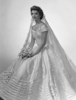 Photo by: Courtesy of Getty Images Jacqueline Bouvier: The Camelot Bride Considered to be the closest thing we've ever had to American royalty, this former First Lady was a shoo-in for our list. In 1953, she married John F. Kennedy in a silk taffeta gown by designer Ann Lowe. Needless to say, she looked exquisite and graceful. More from Lucky: Secrets from Top Dermatologists 50 Unique Engagement Rings