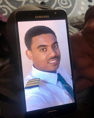 Menur Mohamed, brother to Ethiopian Airlines ET 302 First Officer Ahmednur Mohamed, holds his phone with a photograph of his brother during a Reuters interview in Addis Ababa, March 17, 2019. REUTERS/Maggie Fick