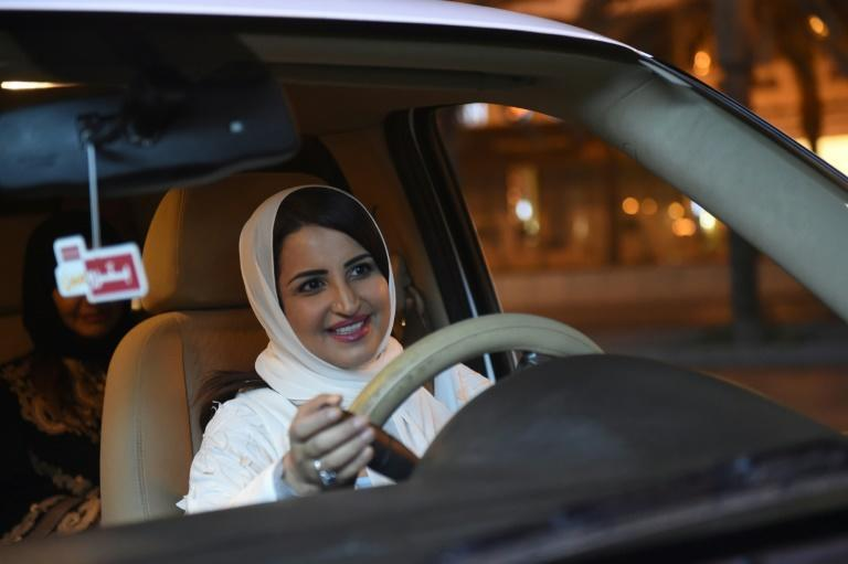 A Saudi woman gets behind the wheel on June 24, 2018, after the kingdom ended the world's only ban on female motorists (AFP/FAYEZ NURELDINE)