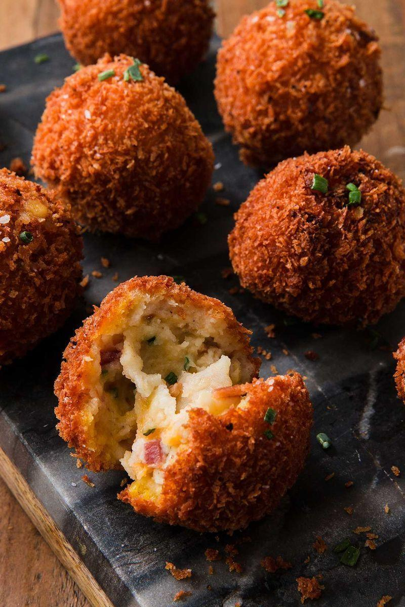 """<p>This easy recipe turns those sad leftover mashed potatoes into something MAGICAL.</p><p>Get the <a href=""""https://www.delish.com/uk/cooking/recipes/a29245081/fried-mashed-potato-balls-recipe/"""" rel=""""nofollow noopener"""" target=""""_blank"""" data-ylk=""""slk:Fried Mashed Potato Balls"""" class=""""link rapid-noclick-resp"""">Fried Mashed Potato Balls</a> recipe.</p>"""
