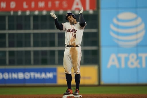 Houston Astros' George Springer reacts after hitting an RBI double during the eighth inning of Game 1 of the baseball World Series against the Washington Nationals Tuesday, Oct. 22, 2019, in Houston. (AP Photo/David J. Phillip)