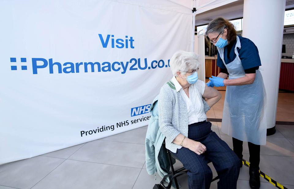 EDITORIAL USE ONLY Christina Watkins, aged 82, from Aylesbury is one of the first people to receive the Oxford/AstraZeneca vaccine at the opening of the first Pharmacy2U Covid-19 vaccination centre at the Odeon Cinema in Aylesbury.