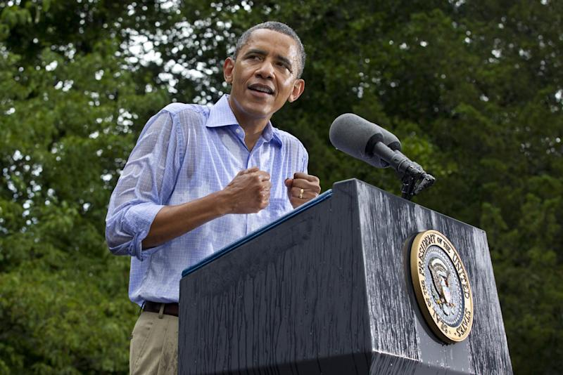 President Barack Obama holds a campaign rally in a downpour at the historic Walkerton Tavern & Gardens in Glen Allen, Va., near Richmond, Va., Saturday, July 14, 2012. It is in the Congressional district represented by House Majority Leader Eric Cantor, R-Va., a key county in a crucial swing state, part of a region that could decide the fight for Virginia's 13 critical electoral votes. (AP Photo/J. Scott Applewhite)