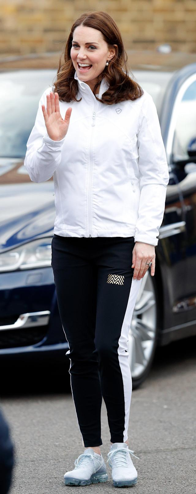 Kate looked ready to play in silver sneakers, athletic pants and a white windbreaker at the Wimbledon Junior Tennis Initiative in Jan. 2018.
