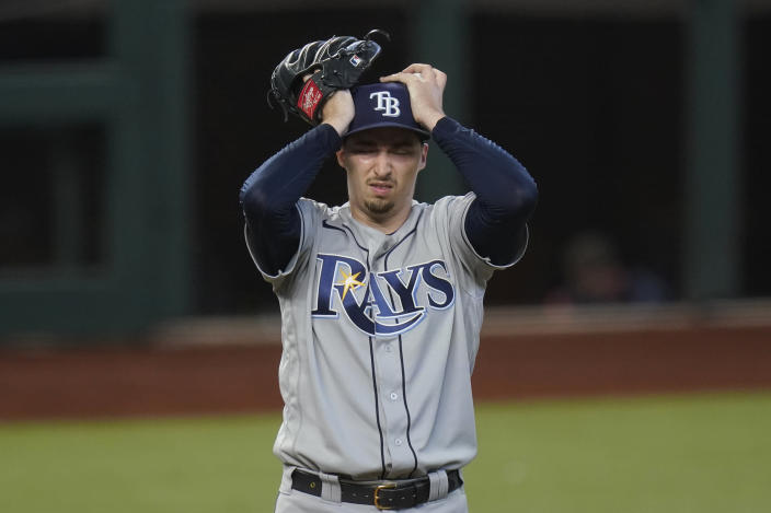 Tampa Bay Rays starting pitcher Blake Snell reacts after giving up two-run home run to Los Angeles Dodgers' Chris Taylor during the fifth inning in Game 2 of the baseball World Series Wednesday, Oct. 21, 2020, in Arlington, Texas. (AP Photo/Eric Gay)