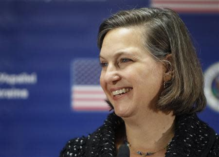U.S. Assistant Secretary of State Victoria Nuland smiles as she addresses a news conference at the U.S. embassy in Kiev February 7, 2014. REUTERS/Gleb Garanich