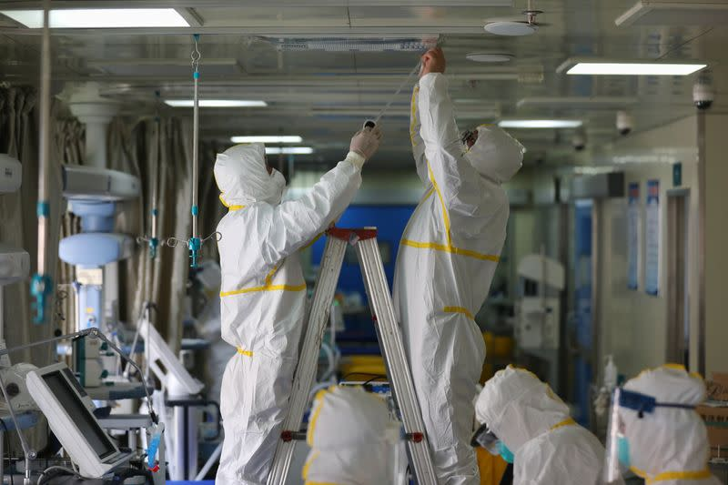 Medical workers in protective suits disinfect an intensive care unit (ICU) ward of Union Jiangbei Hospital in Wuhan, the epicentre of the novel coronavirus outbreak