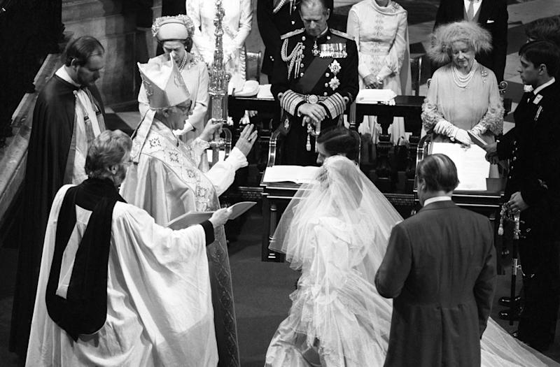 Prince Charles and Princess Diana kneel before the Archbishop of Canterbury Robert Runcie during their 1981 wedding (PA Archive/PA Images)
