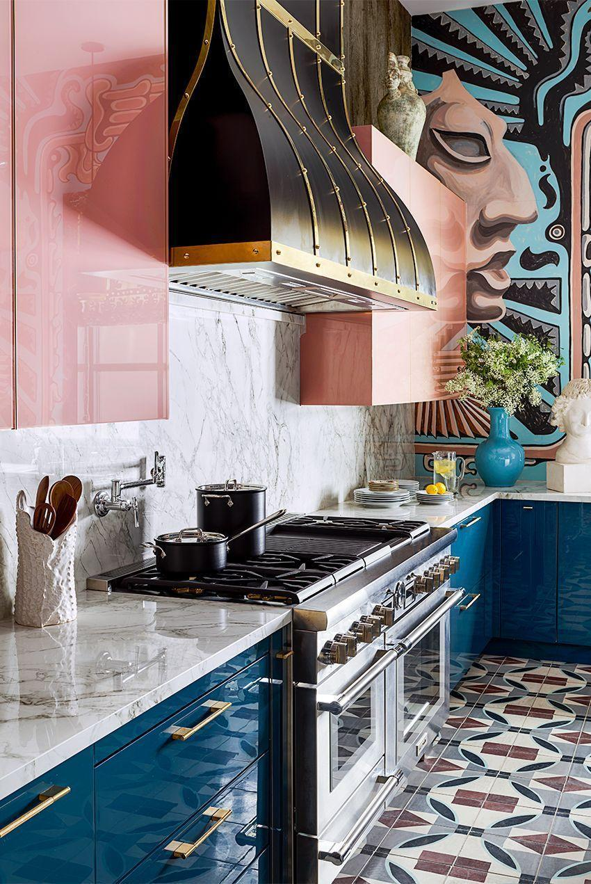 <p>Here's another show-stopper brought to you by Michelle Nussbaumer. The blush pink and deep aqua lacquered cabinets are reflective, which means they make the space feel large (like the classic mirror trick, but colorful).</p>