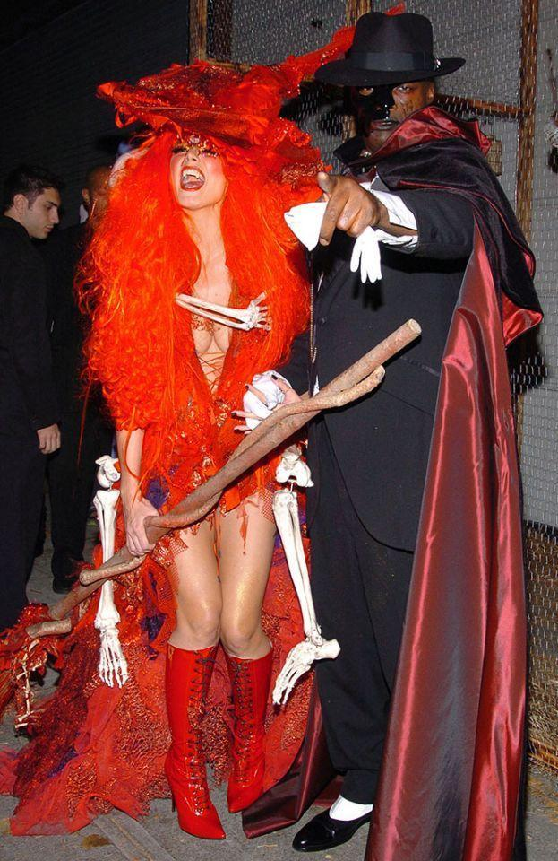 <p>No. 9: In 2004, Klum again took a traditional Halloween costume — the standard witch outfit — and fired it up. In addition to her sexy red bodysuit and lace-up boots, she sported a wild wig and fun hat. The star (pictured with Seal as the Phantom of the Opera) suffered for the cause too: The skeleton was attached to a backpack under her costume that weighed about 50 pounds. But that didn't stop Klum from making a big entrance! She rode in on her broomstick with the help of a harness, proving she'd go to great heights to delight her guests. (Photo: Lawrence Lucier/FilmMagic) </p>