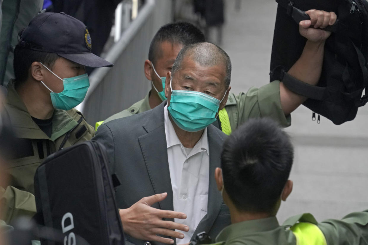 Democracy advocate Jimmy Lai leaves the Hong Kong's Court of Final Appeal, Tuesday, Feb. 9, 2021. The court on Tuesday denied bail for government critic and newspaper publisher Lai who is facing charges under a sweeping new national security law. (AP Photo/Kin Cheung)