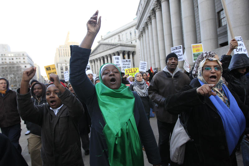 Fatima Akbar, center, marches with her son Shafiyu, 11,  left, and Ayesha Mohammed, right, towards the New York Police Department headquarters during a rally asking for the resignation of NYPD Commissioner Ray Kelly and NYPD spokesperson Paul Browne, in a demand for independent community control of the NYPD, and a well-funded oversight mechanism with subpoena power, Friday, Feb. 3, 2012 in New York.  Thirty-three civil rights groups from around America complained to the New York attorney general Friday about police documents that showed the New York Police Department recommending increased surveillance of Shiite mosques based solely on their religion. The letter urged Attorney General Eric Schneiderman to investigate NYPD's surveillance operations, which monitored entire neighborhoods and built databases about everyday life in Muslim communities. (AP Photo/Mary Altaffer)