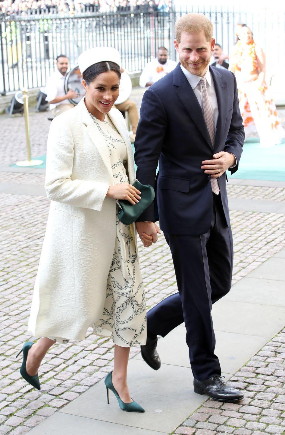 "<p>Meghan Markle arrived at the Commonwealth Day service at Westminster Abbey wearing a white coat and <a href=""https://www.modaoperandi.com/victoria-beckham-fw19/chain-link-print-cady-dress?"" rel=""nofollow noopener"" target=""_blank"" data-ylk=""slk:printed dress by Victoria Beckham"" class=""link rapid-noclick-resp"">printed dress by Victoria Beckham</a>. The Duchess topped off her look with a white pill-box hat, a dark green satin clutch and pumps. </p><p><a class=""link rapid-noclick-resp"" href=""https://go.redirectingat.com?id=74968X1596630&url=https%3A%2F%2Fwww.modaoperandi.com%2Fvictoria-beckham-fw19%2Fchain-link-print-cady-dress&sref=https%3A%2F%2Fwww.townandcountrymag.com%2Fstyle%2Ffashion-trends%2Fg3272%2Fmeghan-markle-preppy-style%2F"" rel=""nofollow noopener"" target=""_blank"" data-ylk=""slk:Shop Now"">Shop Now</a> <em>Chain-Link Print Cady Dress, Victoria Beckham, $1,590</em></p>"