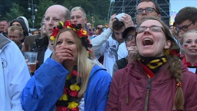 Fans in Berlin rejoice as Toni Kroos rescues Germany's World Cup hopes in dramatic fashion, curling in a stunning free-kick deep into injury time to seal a 2-1 win against Sweden.