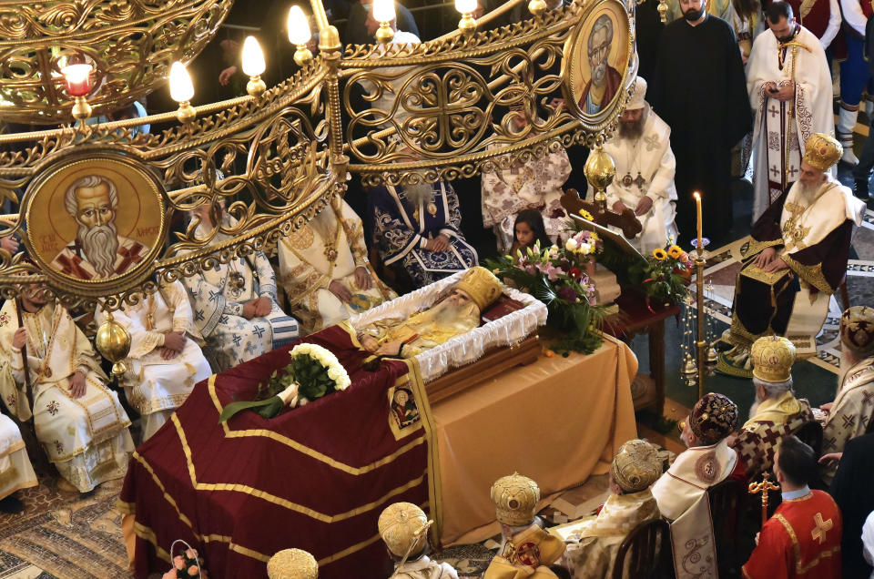 An open casket with Bishop Amfilohije's body during the liturgy and funeral in the main temple in the capital Podgorica, Montenegro, Sunday, Nov. 1, 2020. Bishop Amfilohije died on Friday after contracting the coronavirus weeks ago. A mass funeral on Sunday was held for the popular head of the Serbian Orthodox Church in Montenegro in violation of restrictions that are in place against the new coronavirus. (AP Photo/Risto Bozovic)