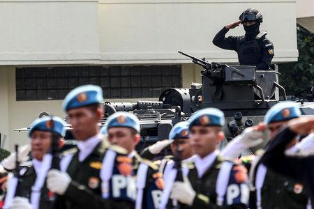 Presidential security squads (Paspampres) take part in a drill, ahead of the announcement of the presidential election results after the last month election, in Jakarta
