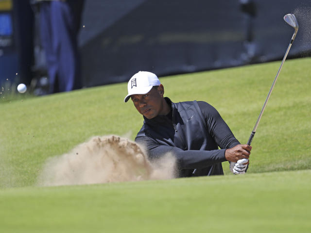 """<a class=""""link rapid-noclick-resp"""" href=""""/pga/players/147/"""" data-ylk=""""slk:Tiger Woods"""">Tiger Woods</a> will be back in action this week at The Open Championship, his first competitive round since the U.S. Open last month. (AP/Peter Morrison)"""