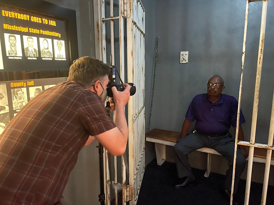 USA Today journalist Jasper Colt photographs Hezekiah Watkins as he sits for a portrait in a recreated jail cell in the Mississippi Civil Rights Museum.