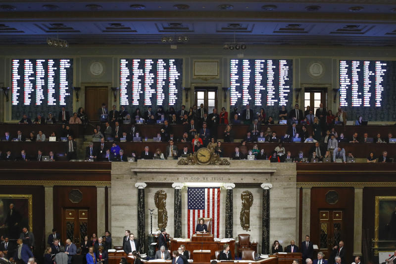 House members vote as House Speaker Nancy Pelosi of Calif., stands on the dais, during a vote on article II of impeachment against President Donald Trump, Wednesday, Dec. 18, 2019, on Capitol Hill in Washington. (AP Photo/Patrick Semansky)