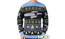 """<p>Set your phasers to stunning; this is one of the most elaborate, cleverly designed ugly Christmas sweaters we've seen. <strong><a rel=""""nofollow noopener"""" href=""""https://middleofbeyond.com/collections/movietv/products/star-trek-sweater"""" target=""""_blank"""" data-ylk=""""slk:Buy here"""" class=""""link rapid-noclick-resp"""">Buy here</a></strong> </p>"""