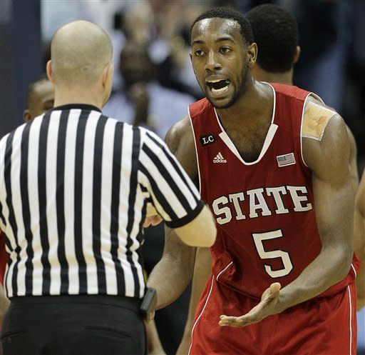 North Carolina State forward C.J. Leslie (5) reacts to fouling out and speaks to an official against North Carolina during the second half of an NCAA college basketball game in the semifinals of the Atlantic Coast Conference tournament, Saturday, March 10, 2012, in Atlanta. (AP Photo/Chuck Burton)