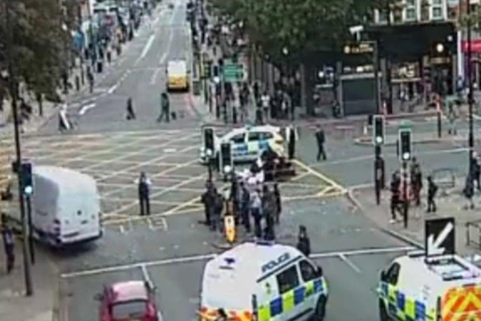 The scene as police carry out first aid on the female rider  (TfL)