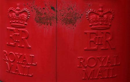 Paint peels on Royal Mail post boxes outside a sorting office in Altrincham, northern England September 12, 2013. REUTERS/Phil Noble