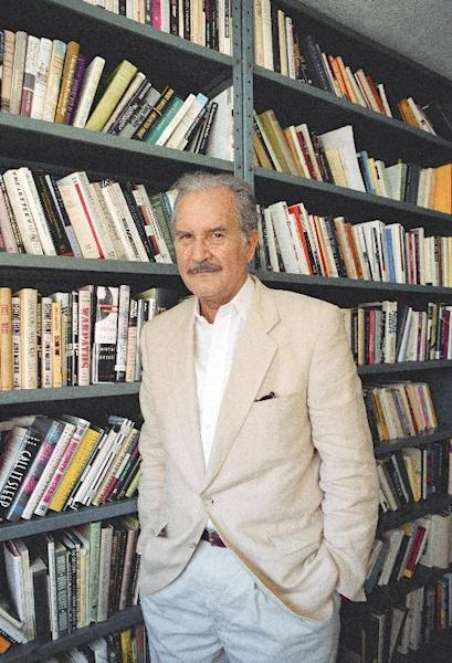 FILE.- In this Oct. 1995 file photo Mexican author Carlos Fuentes posses for a picture at an unknown location. Whatever they may have thought of his politics, anyone lucky enough to have conversed with Carlos Fuentes couldn't help but be taken by his patrician good looks and his love affair with language. Fuentes died in Mexico City Tuesday at the age of 83.(AP Photo/Rick Maiman, File )