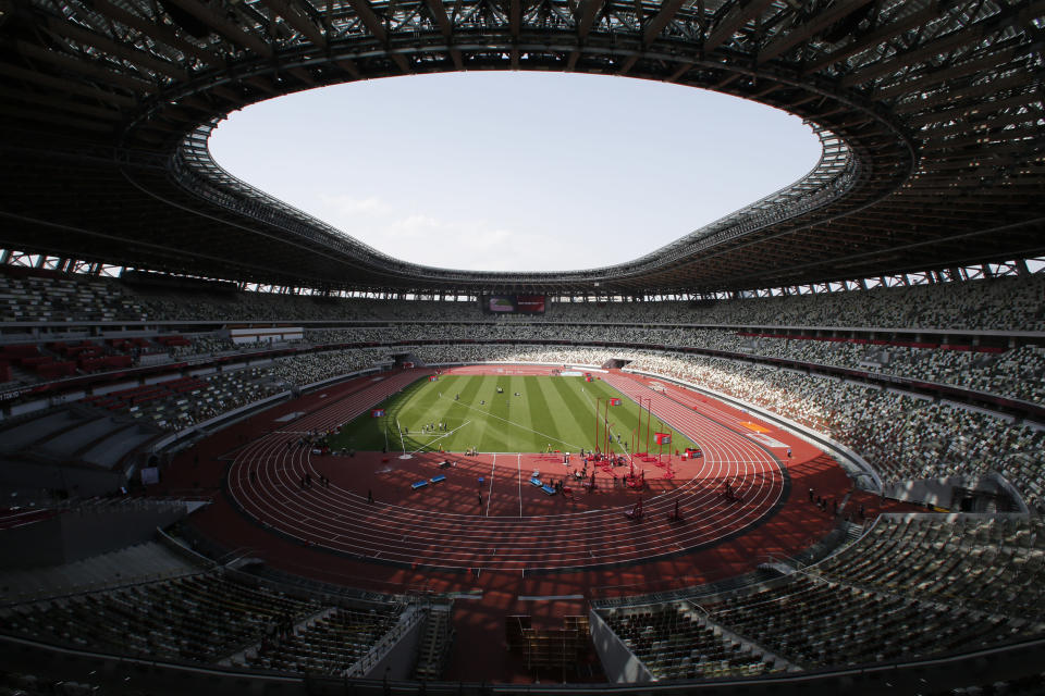 FILE - This May 9, 2021, file photo shows a general view of National Stadium during an athletics test event for the Tokyo 2020 Olympics Games in Tokyo. The Tokyo Olympics, already delayed by the pandemic, are not looking like much fun: Not for athletes. Not for fans. And not for the Japanese public, who are caught between concerns about the coronavirus at a time when few are vaccinated on one side and politicians who hope to save face by holding the games and the International Olympic Committee with billions of dollars on the line on the other. (AP Photo/Shuji Kajiyama, File)
