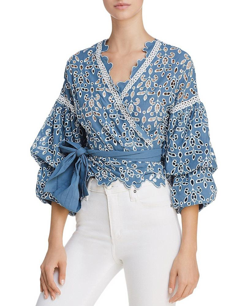 """Get it <a href=""""https://www.bloomingdales.com/shop/product/saylor-eyelet-lace-wrap-top?ID=2804334&amp;CategoryID=2910&amp;linkModule=1#fn=spp%3D4"""" target=""""_blank"""">here</a>.&nbsp;"""