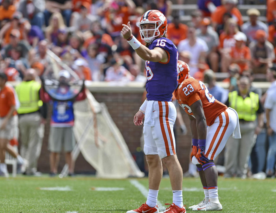 Clemson's Trevor Lawrence signals a play during Clemson's annual Orange and White NCAA college football spring scrimmage Saturday, April 6, 2019, in Clemson, S.C. (AP Photo/Richard Shiro)