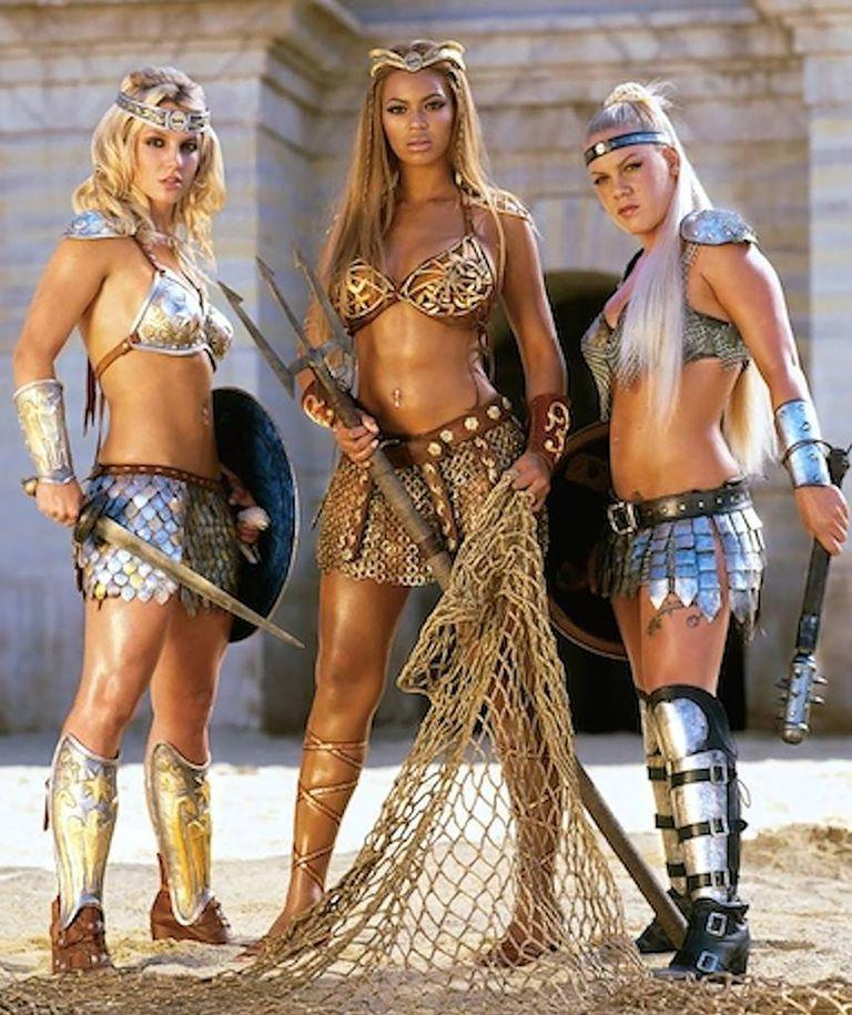 "<p>2004's ultimate squad goals: Beyoncé, Britney Spears, and Pink all starred in perhaps the most iconic Super Bowl ad of all time. Dressed in epic gladiator-of-the-early-aughts outfits, the trio turned ""We Will Rock You"" into a <a href=""https://www.bustle.com/articles/60480-remember-beyonces-2004-super-bowl-commercial-pink-britney-spears-were-there-too"" rel=""nofollow noopener"" target=""_blank"" data-ylk=""slk:power-girl anthem"" class=""link rapid-noclick-resp"">power-girl anthem</a>.</p>"