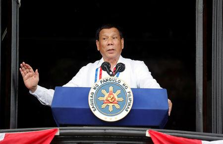 Philippine's President Rodrigo Duterte speaks during the 120th Philippine Independence day celebration at the Emilio Aguinaldo shrine in Kawit, Cavite