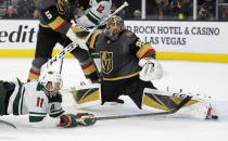 Vegas Golden Knights goaltender Marc-Andre Fleury (29) blocks a shot by Minnesota Wild left wing Zach Parise (11) during the first period of an NHL hockey game Tuesday, Dec. 17, 2019, in Las Vegas. (AP Photo/John Locher)