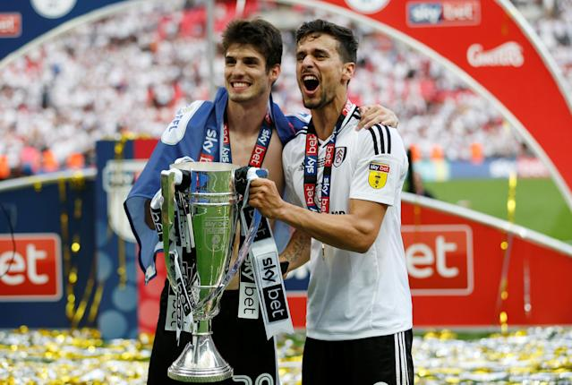 "Soccer Football - Championship Play-Off Final - Fulham vs Aston Villa - Wembley Stadium, London, Britain - May 26, 2018 Fulham's Lucas Piazon and Rui Fonte celebrate promotion to the Premier League with the trophy Action Images via Reuters/Carl Recine EDITORIAL USE ONLY. No use with unauthorized audio, video, data, fixture lists, club/league logos or ""live"" services. Online in-match use limited to 75 images, no video emulation. No use in betting, games or single club/league/player publications. Please contact your account representative for further details."