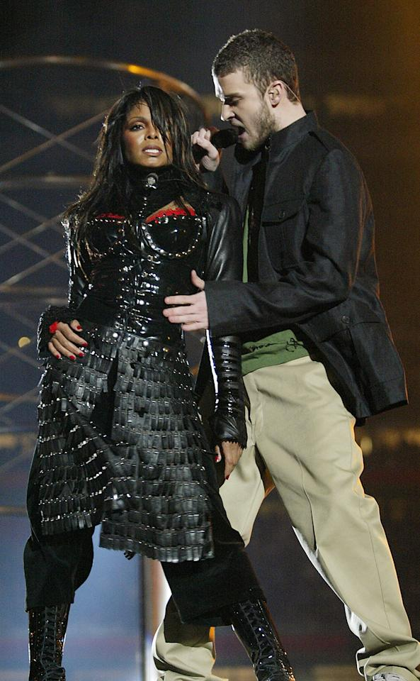 Janet Jackson and surprise guest Justin Timberlake perform during the halftime show at Super Bowl XXXVIII between the New England Patriots and the Carolina Panthers at Reliant Stadium on February 1, 2004 in Houston, Texas.  At the end of the performance, Timberlake tore away a piece of Jackson's outfit.  (Photo by Frank Micelotta/Getty Images)