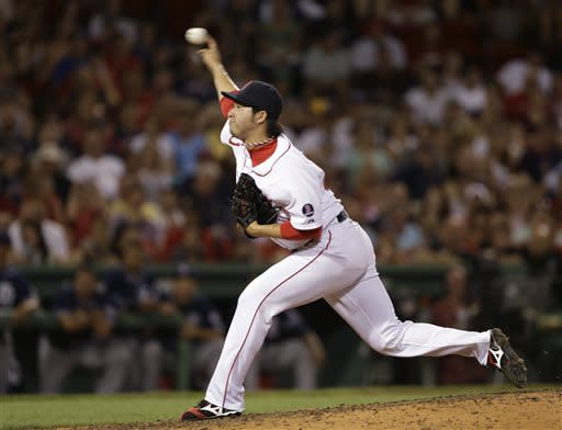 Boston Red Sox relief pitcher Junichi Tazawa delivers to the San Diego Padres in the eighth inning of an interleague baseball game at Fenway Park in Boston, Wednesday, July 3, 2013. (AP Photo/Elise Amendola)