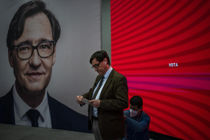 Catalan Socialist Party (PSC) candidate in the upcoming Catalan elections Salvador Illa, reads notes ahead of an interview at his party headquarter in Barcelona, Spain, Monday, Feb. 8, 2021. A former health minister of Spain hopes to become a quiet political disruptor in the country's Catalonia region when voters go to the polls next weekend. (AP Photo/Emilio Morenatti)
