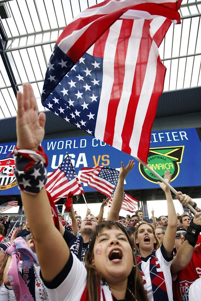 Fans gesture before a World Cup qualifier soccer match between the United States and Jamaica at Sporting Park in Kansas City, Kan., Friday, Oct. 11, 2013. (AP Photo/Colin E. Braley)