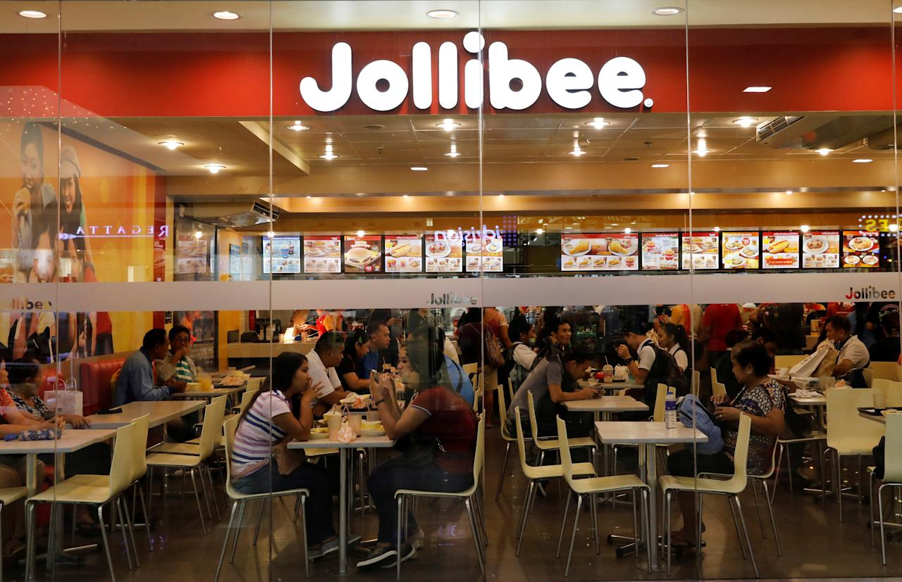 Customers eat at a Jolibee fastfood outlet in Quezon City, metro Manila, Philippines September 22, 2017. REUTERS/Dondi Tawatao