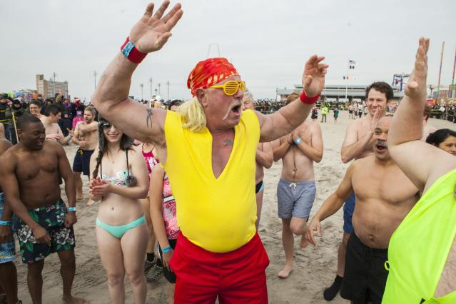 CONEY ISLAND, NY - JANUARY 1: A man dressed as Hulk Hogan waits to run into the water just off the Boardwalk January 1, 2014 at Coney Island in the Brooklyn borough of New York City. Hundreds of people gathered for the annual New Year's Day Polar Bear swim in the ocean. (Photo by Christopher Gregory/Getty Images)