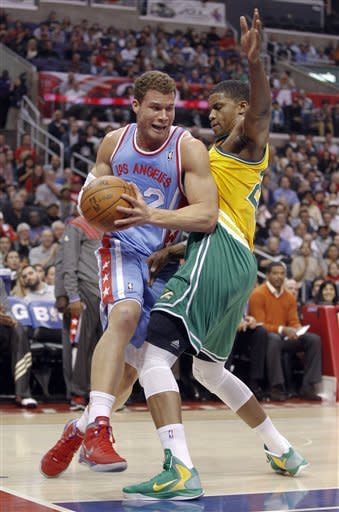 Los Angeles Clippers forward Blake Griffin, left, drives around Memphis Grizzlies forward Rudy Gay during the first half of an NBA basketball game in Los Angeles, Thursday, Jan. 26, 2012. (AP Photo/Chris Carlson)