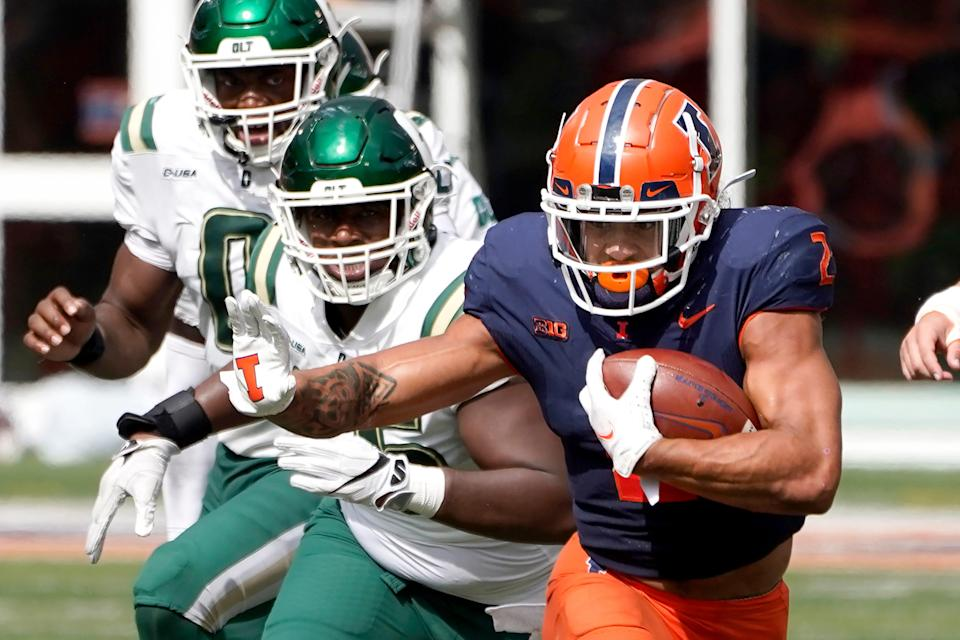 Illinois running back Chase Brown during the second half of an NCAA college football game against Charlotte Saturday, Oct. 2, 2021, in Champaign, Ill. Illinois won 24-14. (AP Photo/Charles Rex Arbogast)